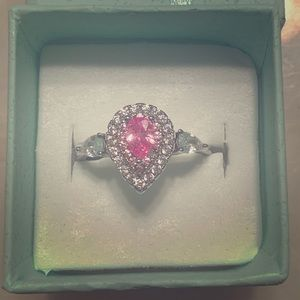 Sterling silver pink pear shaped halo ring